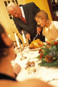 Man Carving Turkey at Christmas Dinner